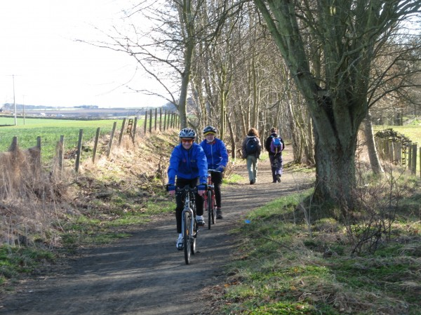 Walkers and cyclists on the Dronley Railway Path in Angus